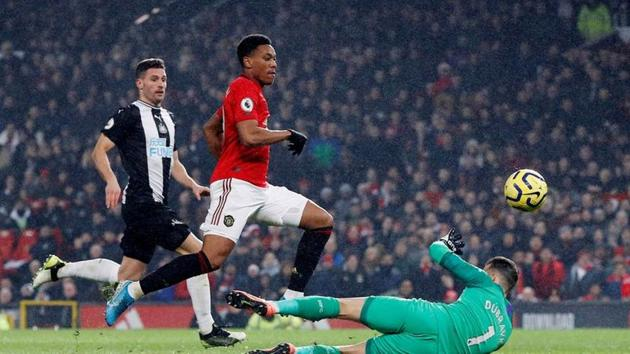 Soccer Football - Premier League - Manchester United v Newcastle United - Old Trafford, Manchester, Britain - December 26, 2019 Manchester United's Anthony Martial scores their fourth goal REUTERS/Phil Noble(REUTERS)