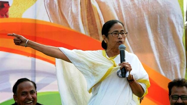 West Bengal Chief Minister Mamata Banerjee addresses Trinamool Congress supporters during a protest rally against CAA and NRC, in Kolkata on Tuesday.(ANI Photo)