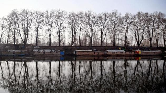 Houseboats moored on the banks of Dal Lake during a winter day in Srinagar.(ANI Photo)