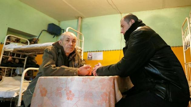 Boris Pundor and Alexander Geimur, prisoners of war (POWs) from the Ukrainian armed forces, are seen inside a cell at a penitentiary colony during a demonstration for the media in the rebel-controlled settlement of Makiivka (Makeyevka) outside Donetsk, Ukraine.(REUTERS)