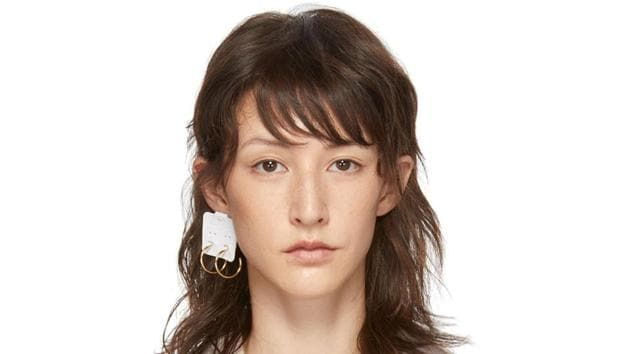 The confusing earring was noticed by Twitter user @doragzplora who posted it with this caption.(Maison Margiela/ www.ssense.com)