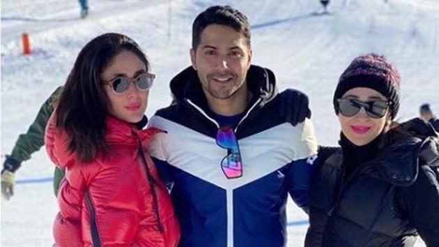 Kareena Kapoor, Karisma Kapoor, and Varun Dhawan pose together in Switzerland.
