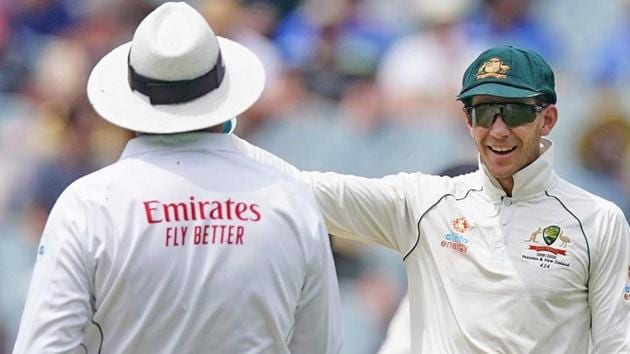 Tim Paine gestures at the giant screen to on-field umpire Marais Erasmus.(cricket.com.au/ Twitter)