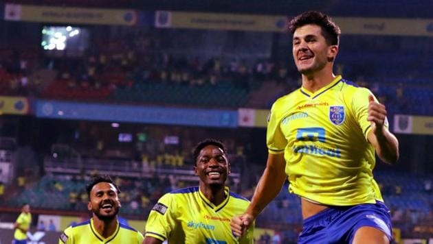 Kerala Blasters FC players (in yellow) celebrate after scoring a goal.(PTI)