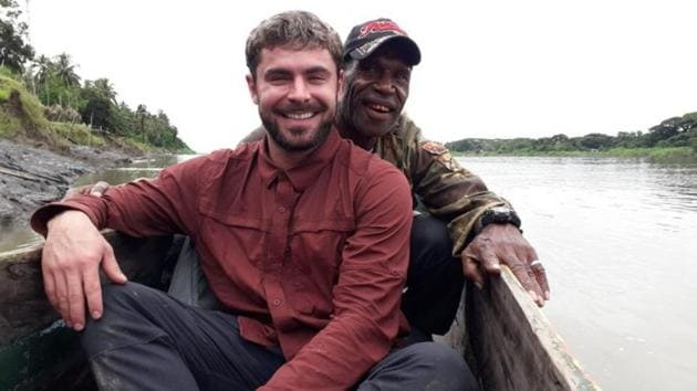 Zac Efron poses with his guide in Papua New Guinea.(Facebook)