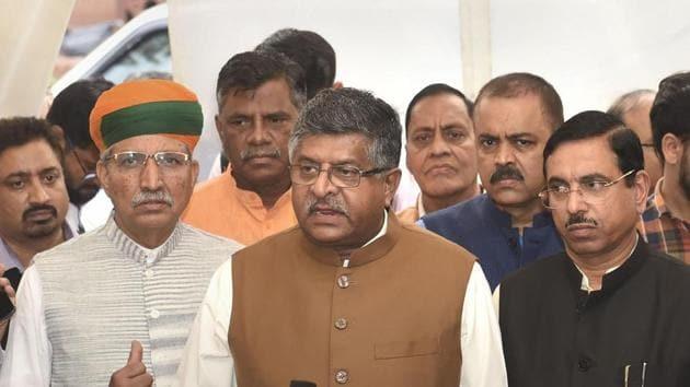 Union Ministers Ravi Shankar Prasad, Arjun Ram Meghwal and Pralhad Joshi address the media.(PTI Photo)