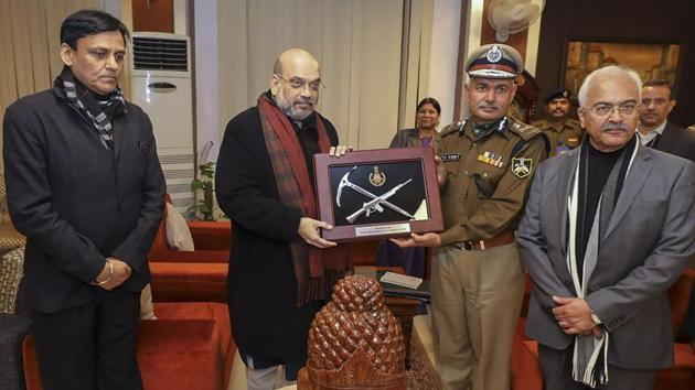 The home minister unveiled the logo during an event, where he laid the foundation for raising a new headquarters building for the CRPF.(PTI)