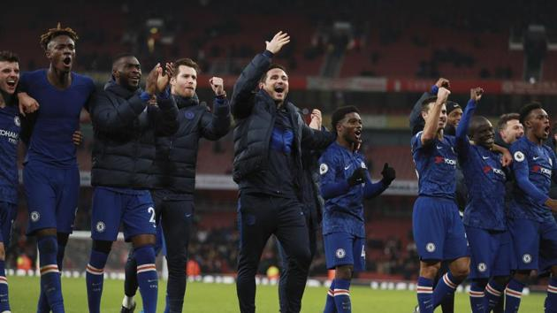 Chelsea's head coach Frank Lampard celebrates with team players.(AP)