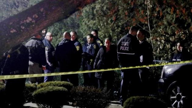 Police gather outside a residence in Monsey, New York, following a mass stabbing during a Hanukkah celebration.(AP)