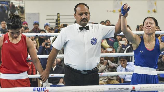 Referee raises the hand of boxer Mary Kom after her bout against Nikhat Zareen.(PTI)