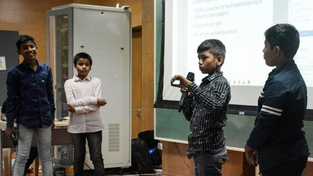 Team members of Gamecation startup from Municipal corporation school explaining their startup ideas at IISER, Pashan.(Milind Saurkar/HT Photo)