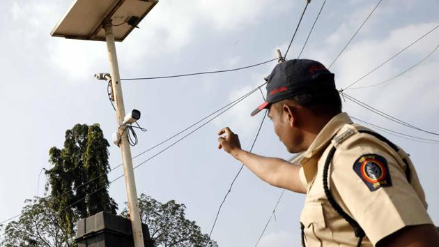 A police official points out to a CCTV camera that has been installed around Vijay Stambh and Vadhu Budruk for security purposes.(Rahul Raut/HT PHOTO)