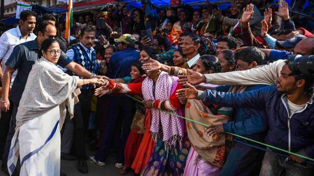 West Bengal Chief Minister Mamata Banerjee meets local people during a protest rally against the amended Citizenship Act and NRC, in Purulia district.(PTI)