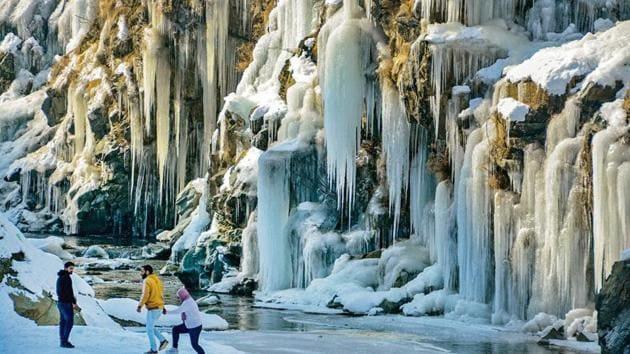 A frozen waterfall at Tangmarg near Srinagar on Monday.(PTI)