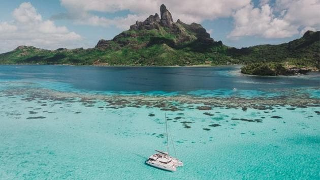 Bora Bora, the tiny French Polynesian island has vast blue beaches and is nature at its best for a destination wedding setting.(Unsplash)