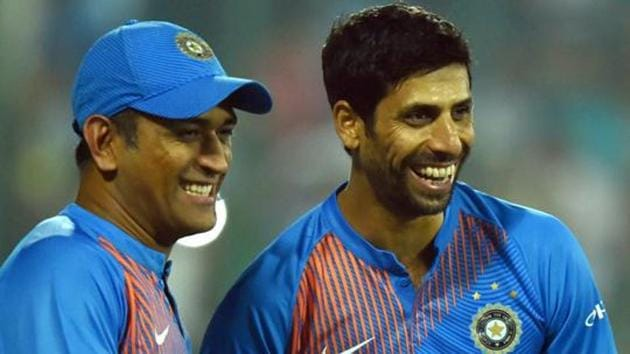 A file photo of Ashish Nehra (R) and MS Dhoni.(PTI)