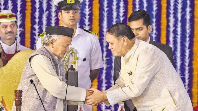 NCP leader from Pune district, Dilip Walse-Patil (right), greets Maharashtra governor Bhagat Singh Koshyari during the swearing-in ceremony for state cabinet expansion at Vidhan Bhavan in Mumbai on Monday.(PTI)