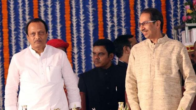 NCP leader Ajit Pawar with chief minister of Maharashtra Uddhav Thackeray after taking oath as deputy chief minister during the swearing-in ceremony at Vidhan Bhavan on Monday.(ANI)
