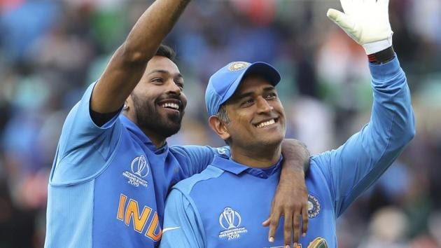 India's MS Dhoni, right, and Hardik Pandya wave towards a gallery.(AP)
