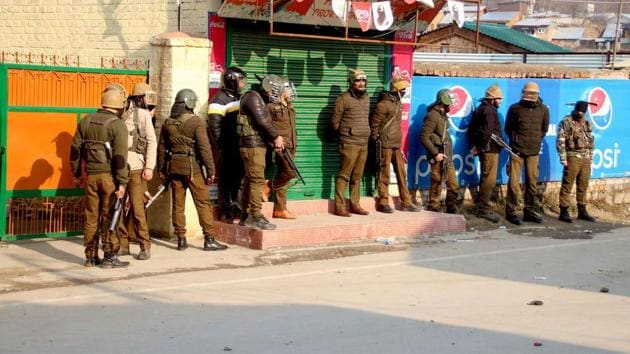 Police personnel stand guard outside a college after clash with students during a protest in Srinagar.(ANI file photo)