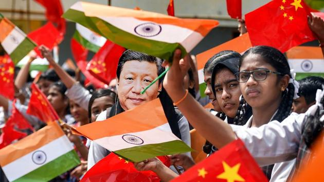 School students wave the national flag of China and India ahead of Chinese President Xi Jinping's visit in Chennai.(Photo: PTI)