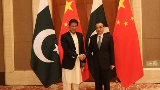 File photo: Pakistan Prime Minister Imran Khan (Left) meets Chinese Premier Li Keqiang at the Great Hall of the People in Beijing.(Courtesy: PM Office Pakistan)