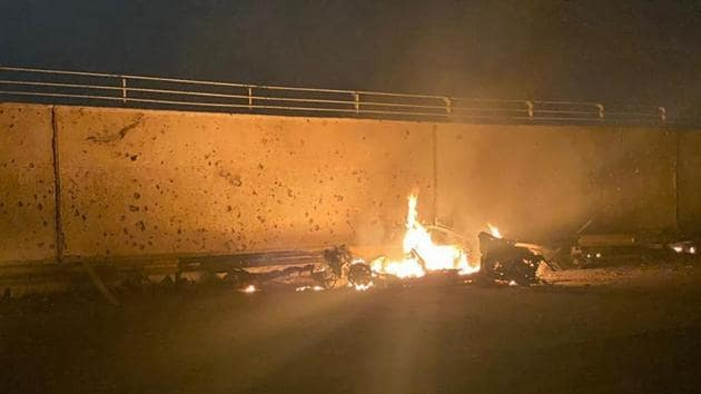 This photo released by the Iraqi Prime Minister Press Office shows a burning vehicle at the Baghdad International Airport following an airstrike, in Baghdad, early on Friday.(AP Photo)