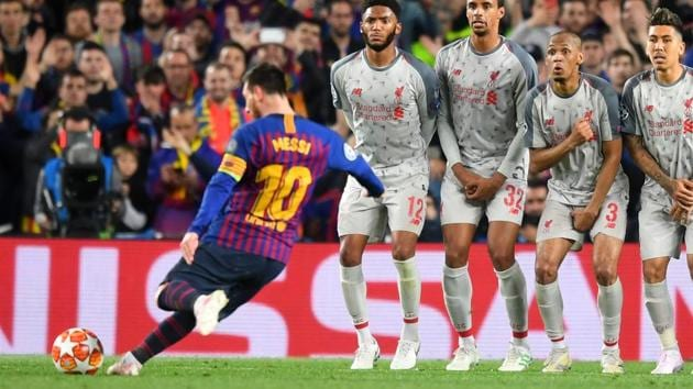 Lionel Messi of Barcelona scores his sides third goal from a free kick during the UEFA Champions League Semi Final first leg match between Barcelona and Liverpool at the Nou Camp on May 01, 2019 in Barcelona, Spain. (Photo by Michael Regan/Getty Images)(Getty Images)