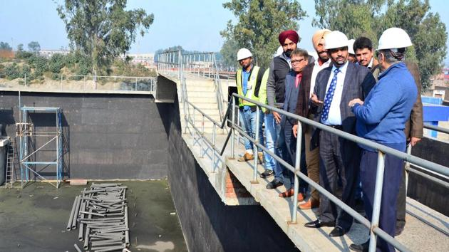 PPCB member secretary Krunesh Garg (second from right) and other PPCB officials at the Tejpur road common effluent treatment plant in Ludhiana on Friday.(GURPREET SINGH/HT)