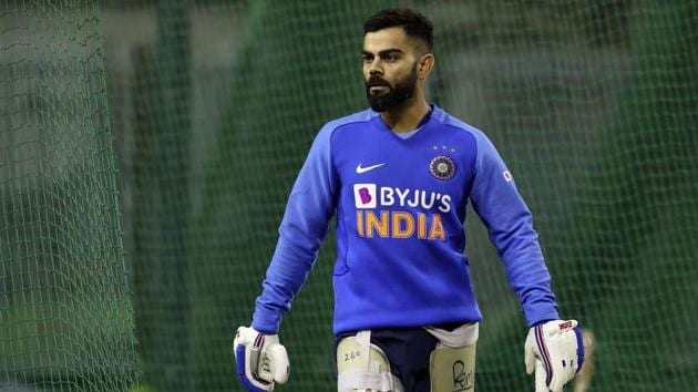 India's captain Virat Kohli walks to bat in the nets during a training session.(AP)