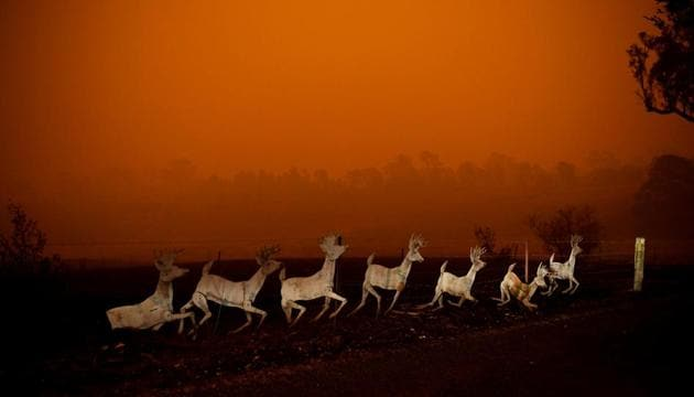 Christmas decorations are seen nearby a destroyed house in Cobargo, as bushfires continue in New South Wales, Australia January 5, 2020.(REUTERS)