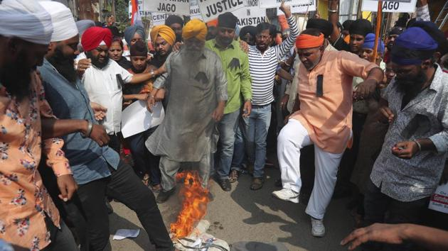 Sikh protestors stamp on a burning effigy of Pakistan Prime Minister Imran Khan during a protest against the alleged vandalism and stoning of the Nankana Saheb, a Sikh shrine in Pakistan, in Hyderabad.(AP)