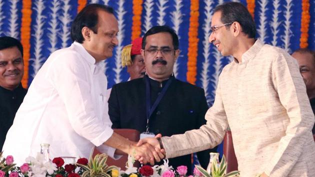 Maharashtra Chief Minister Uddhav Thackeray shakes hand with NCP leader Ajit Pawar as he took oath as Deputy Chief Minister of Maharashtra during the swearing-in ceremony at Vidhan Bhavan in Mumbai on Monday.(ANI file photo)