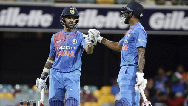 India's Shikhar Dhawan, left, and K.L. Rahul, right, greet during a match.(AP)