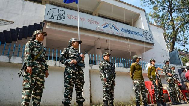 Security personnel stand guard in front of the Asom Gana Parisahad (AGP) head-office on Tuesday after a faction of the party, which is opposing the Citizenship Amendment Act 2019, wanted to hold a meeting, in Guwahati.(PTI)