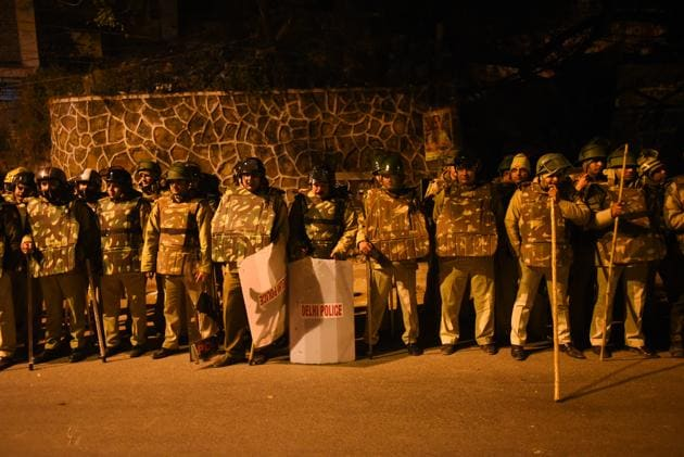 Police personnel are seen outside the main gate of JNU campus, Monday, December 6, 2020.(Amal KS / HT Photo)