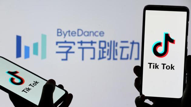 TikTok logos are seen on smartphones in front of a displayed ByteDance logo.(REUTERS)