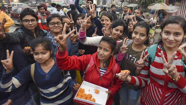 Girls distribute sweets as they celebrate Delhi court's verdict to hang convicts in the 2012 gangrape case, in Patna on Tuesday.(PTI Photo)