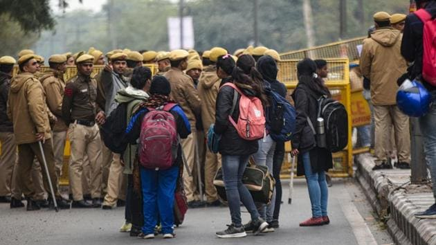 A group of masked men and women armed with sticks and rods unleashed violence on JNU students on Sunday evening.(HT file)