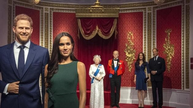 The figures of Britain's Prince Harry and Meghan, Duchess of Sussex, left, are moved from their original positions next to Queen Elizabeth II, Prince Philip and Prince William and Kate, Duchess of Cambridge, at Madame Tussauds in London, Thursday Jan. 9, 2020.(AP)