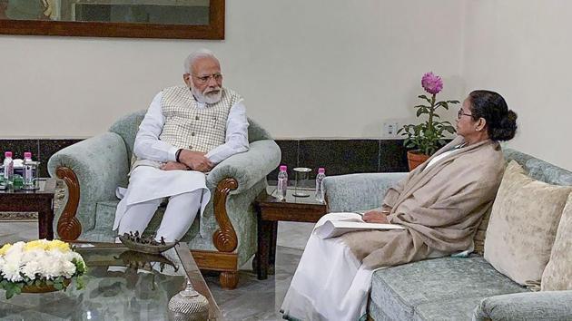 Prime Minister Narendra Modi with West Bengal CM Mamata Banerjee during a meeting in Kolkata on Saturday(PTI Photo)