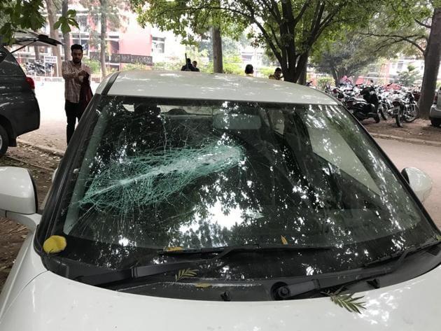 PUCSC vice-president Rahul Kumar's car was vandalised outside boys' hostel number 4 of the university.(HT PHOTO)
