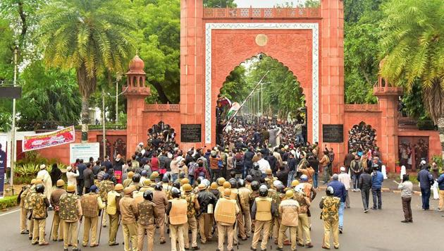 Police personnel stand guard outside Aligarh Muslim University (AMU) as students protest against the passing of Citizenship Amendment Bill, in Aligarh on December 13, 2019.(PTI File Photo)