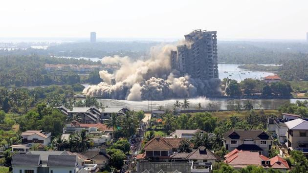 A view of Jain Coral Cove apartment built in violation of Coastal Regulation Zone norms in Maradu Municipality, being demolished through a controlled implosion in Kochi on Sunday.(Vivek R Nair/HT Photo)