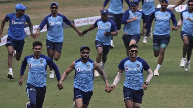 India's cricket captain Virat Kohli, center, along with other players attend a training session in Mumbai(AP)