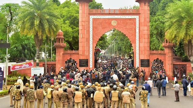 Police personnel outside Aligarh Muslim University (AMU) as students protest against the passing of Citizenship Amendment Bill, in Aligarh on December 13, 2019.(PTI File Photo)