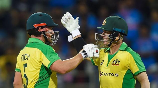 Australian batsmen Aaron Finch and David Warner after completing their centuries.(PTI)