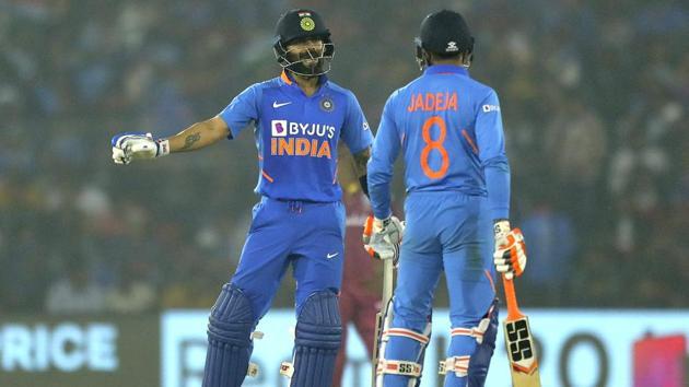 India's captain Virat Kohli, left, interacts with batting partner Ravindra Jadeja(AP)