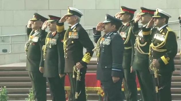 Chief of Defence Staff General Bipin Rawat, Army chief General Manoj Mukund Narawane, chief of the Air Staff Air Chief Marshal RKS Bhadauria and Navy chief Admiral Karambir Singh pay tribute at the National War Memorial on Army Day on Wednesday.(ANI photo)
