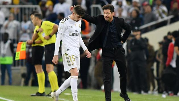 Atletico Madrid coach Diego Simeone with Real Madrid's Federico Valverde who leaves the pitch after being shown a red card by the referee.(REUTERS)
